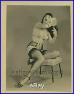 Beautiful semi nude Bettie Page w mirror combing hair vintage pin up photo