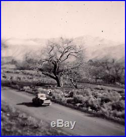 OLD VINTAGE PHOTO PICK-UP TRUCK DRIVING DOWN A COUNTRY ROAD