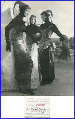 Women in strange costumes vintage art photo by Federico Patellani